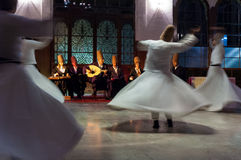 Whirling dervishes. And musicians perform to visitors in the event hall of Sirkeci Train Station, the old terminus of the Orient Express on October 21, 2005 in Stock Photo