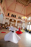 Whirling Dervishes. Perform a sacred mevlana dance at Serkeci Train Station on June 18, 2011 in Istanbul, Turkey Royalty Free Stock Images