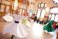 Whirling Dervishes. Perform a sacred mevlana dance at Serkeci Train Station on June 18, 2011 in Istanbul, Turkey Royalty Free Stock Photos