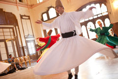 Whirling Dervishes. Perform a sacred mevlana dance at Serkeci Train Station on June 18, 2011 in Istanbul, Turkey Royalty Free Stock Photo