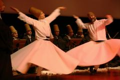 Whirling Dervishes. Twirling mevlana people muslim musician praying spirituality sufi culture mysticism islamic allah sheikh pray istanbul blur initiation islam Stock Photos
