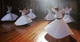 Whirling derwishes during traditional ceremony Stock Photo