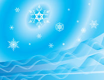 Whirling snowflakes on a blue background Royalty Free Stock Photography