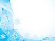 Whirling snowflakes on a blue background Royalty Free Stock Image
