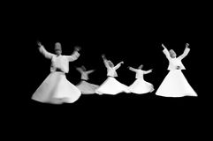Whirling Turkish mevlevi dervis in worship show in Istanbul Turkey Royalty Free Stock Image