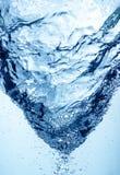 Whirlpool underwater. Wild whirlpool in blue underwater Royalty Free Stock Image