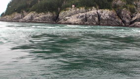Whirlpool of water of Pacific Ocean on background amazing landscapes Alaska. stock video footage