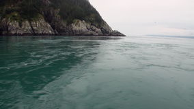 Whirlpool of water of Pacific Ocean on background amazing landscapes Alaska. stock footage