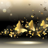 Whirlwind of butterflies. Whirlwind of gold butterflies on a dark background Royalty Free Stock Images