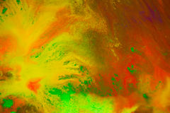 Whirlwind vortex spreads colored ink colors on a white background Stock Images