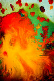 Whirlwind vortex spreads colored ink colors on a white background Royalty Free Stock Image