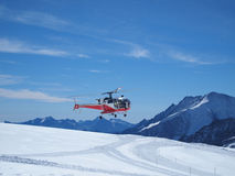 Whirlybird copter at Jungfraujoch Switzerland. Vehicles flying helicopter for rescue Life at Jungfraujoch Top of Europe in the Swiss Mountains Stock Photos