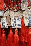 Whishing Plaque (Ema) with Chinese decorative knots. Hanging up at the Tanzhe Temple, Beijing, China Stock Photography