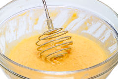 Whisk batter in the bowl Royalty Free Stock Image