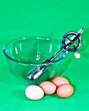 Whisk, bowl, eggs Royalty Free Stock Photo