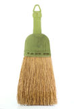 Whisk Broom. Small whisk broom with green handle  on white Royalty Free Stock Photo