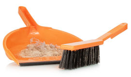 Whisk broom and dustpan with dirt Stock Photography