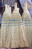 Whisk brooms on an open market. Under sunlight Royalty Free Stock Photo