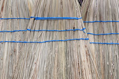 Whisk brooms on an open market. Under sunlight Royalty Free Stock Image