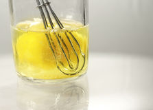 Whisk and egg in glass jar Stock Photo