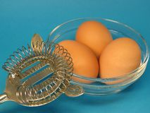 Whisk and eggs Stock Photo