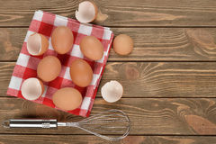 Whisk and eggs Stock Photography