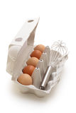 Whisk and eggs. Stock Images