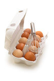 Whisk and eggs. Stock Photos