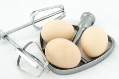 Whisk and eggs Royalty Free Stock Image
