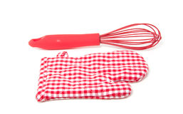 A whisk and a kitchen glove Stock Photos