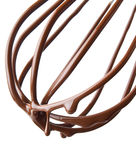 Whisk with melted chocolate over white Stock Images