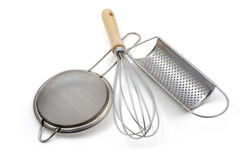 Whisk, strainer and grater. Isolated over white Royalty Free Stock Photos