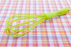 Whisk on a table. Stock Image