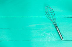 Whisk on turquoise wood as background Stock Photography
