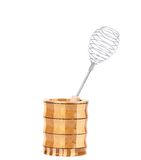 Whisk in wooden jar. Stock Photo