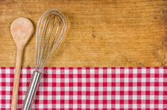 Whisk and wooden spoon Stock Image