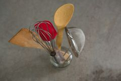 Whisker, wooden spoon, strainer and spatula. Close-up of whisker, wooden spoon, strainer and spatula stock image