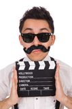 Whiskered young man with clapperboard isolated on Stock Photo