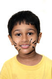Whiskers. An handsome Indian kid happy with whiskers on face royalty free stock image