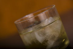 Whiskey. In a soft light warm backgroung Royalty Free Stock Images