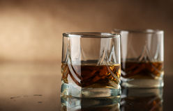 Whiskey. Glass of whisky on a dark background Royalty Free Stock Photos