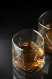 Whiskey. Glass of whisky on a dark background Stock Images