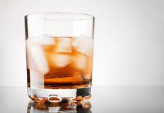 Whiskey. Glass of whisky with ice Royalty Free Stock Photos