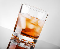 Whiskey. Glass of whisky with ice Royalty Free Stock Image