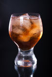 Whiskey. With ice in a glass on a black background stock photography