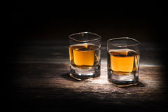 Whiskey. Glass of whiskey on wooden background close up stock images