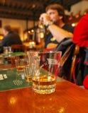 WHISKEY. Drinking of whiskey in an irish pub Royalty Free Stock Image