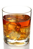Whiskey. Glass of whiskey on rocks isolated on white stock photo