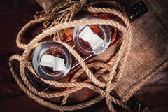 Whiskey aged elite alcohol on wooden background Royalty Free Stock Photos