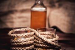 Whiskey aged elite alcohol on wooden background Stock Image
